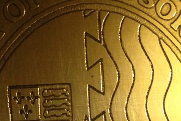 Etched brass crest